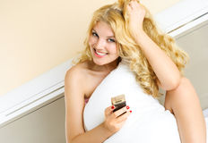 Pretty girl with a cellphone at home Stock Photography