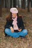 Pretty girl with cellphone outdoors Stock Photo