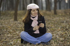 Pretty girl with cellphone outdoors Stock Photography