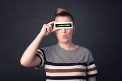 Pretty girl with censored paper sign Royalty Free Stock Photography