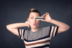 Pretty girl with censored paper sign Stock Photos