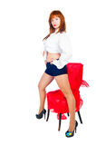 Pretty girl on chair Royalty Free Stock Photography