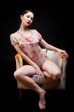 Pretty girl on chair Royalty Free Stock Photo