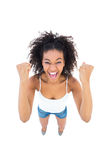 Pretty girl cheering at camera Royalty Free Stock Photo