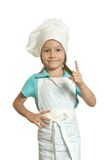 Pretty girl in chef uniform Royalty Free Stock Image