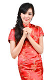 Pretty girl with cheongsam wishing you a happy Chinese new year Stock Photos