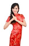 Pretty girl with cheongsam wishing you a happy Chinese new year Royalty Free Stock Photos