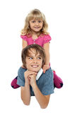 Pretty girl child playing with her brother Royalty Free Stock Photos