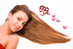 Pretty girl and chocolate hearts Royalty Free Stock Photo