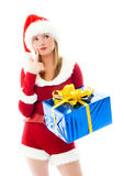 Pretty girl choosing Christmas presents Royalty Free Stock Images