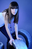 Pretty girl choosing wheels Royalty Free Stock Photography