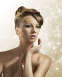 Pretty girl with christmas decoration on face Stock Photography