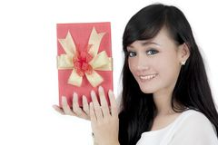 Pretty girl with Christmas gift on studio Royalty Free Stock Photography