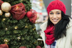 Pretty girl by the Christmas tree Stock Image