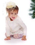 Pretty girl in a Christmas tree Stock Image