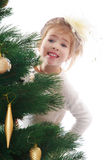 Pretty girl in a Christmas tree Royalty Free Stock Photos