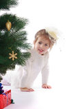 Pretty girl in a Christmas tree Royalty Free Stock Images