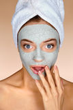 Pretty girl with clay facial mask. Stock Images