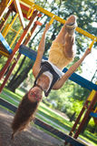 Pretty girl on climbing frame in park Royalty Free Stock Photo
