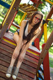 Pretty girl on climbing frame in park Royalty Free Stock Photography