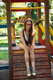 Pretty girl on climbing frame in park Stock Photo