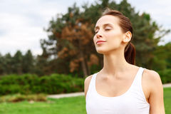 Pretty girl with closed eyes in park Stock Photos