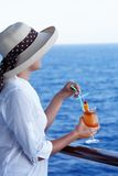Pretty girl with a cocktail on a journey Royalty Free Stock Image