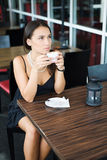 Pretty girl with coffee in cafe Royalty Free Stock Photo