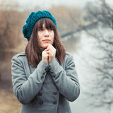 Pretty girl in cold weather in park outdoors, vintage portrait Stock Photos