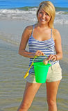 Pretty girl collecting shells Stock Photos