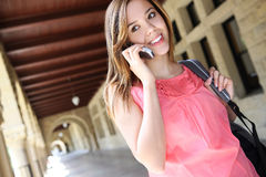 Pretty Girl on College Campus with Backpack Royalty Free Stock Images