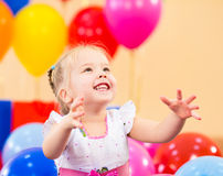 Pretty girl  with colorful balloons and gift Stock Images