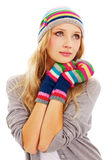 Pretty girl in colorful cap and mittens Royalty Free Stock Photography