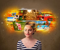 Pretty girl with colorful glowing photo memories concept Stock Photo