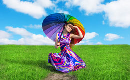 Pretty girl with colorful umbrella resting on the road royalty free stock photography