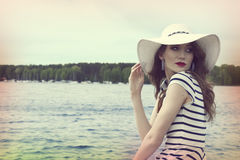 Pretty girl in a commercial shot outside near sea color vintage Stock Photography