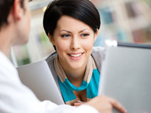 Pretty girl communicates with man at the library Royalty Free Stock Photos