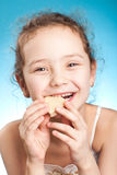 Pretty girl with cookie Stock Image