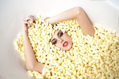 Pretty girl in corn sticks heap Stock Photos