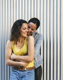 Pretty girl couple hugging each other and smiling, affection, love and same sex relationship concept stock photos