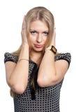 Pretty girl covering er ears Stock Image