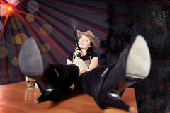 Pretty girl the cowboy with a gun Stock Images