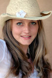 Pretty girl in cowboy hat stock photos