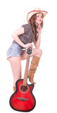 Pretty girl with cowboy hat with guitar Royalty Free Stock Photo