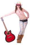 Pretty girl with cowboy hat with guitar Royalty Free Stock Images