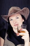 Pretty girl cowboy with whiskey Stock Photos