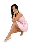 Pretty girl crouching. Royalty Free Stock Photography