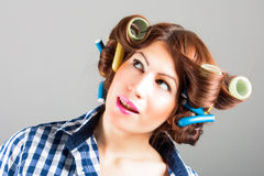 Pretty girl with curlers. Portrait of pretty girl with curlers royalty free stock images