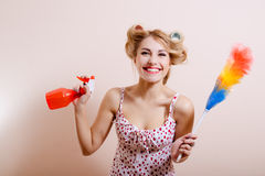 Pretty girl in curlers with red spray and rainbow Royalty Free Stock Photography