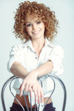 Pretty Girl with Curly Blonde Hair and Toothy Smile Stock Photos